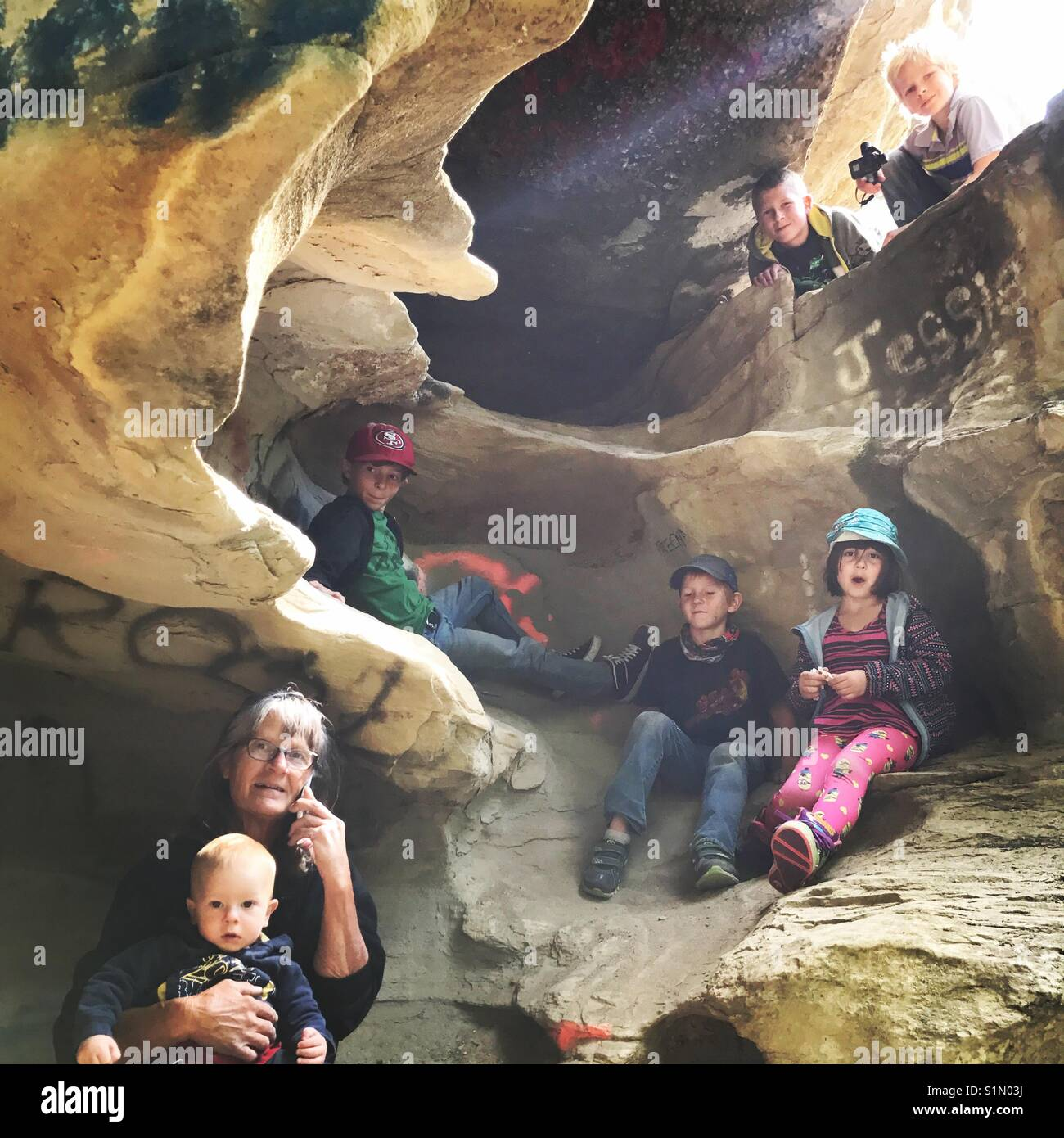 Exploring caves with my family - Stock Image