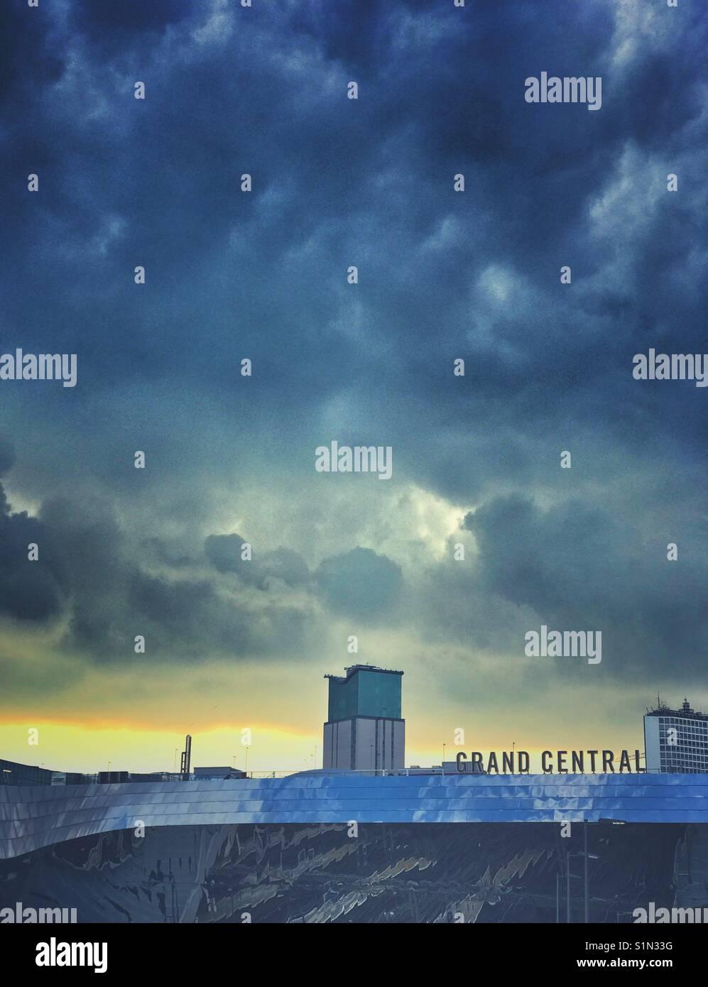 Dark clouds over Grand Central Train Station, Birmingham, UK - Stock Image