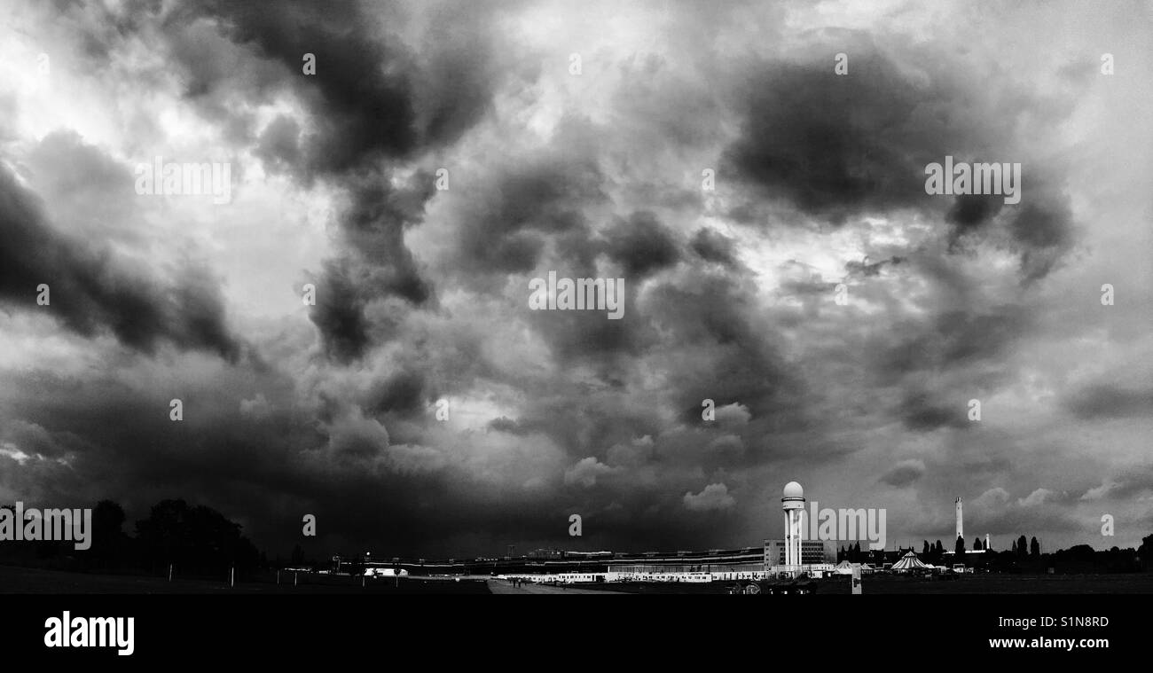 Looming clouds over Tempelhof airport - Stock Image