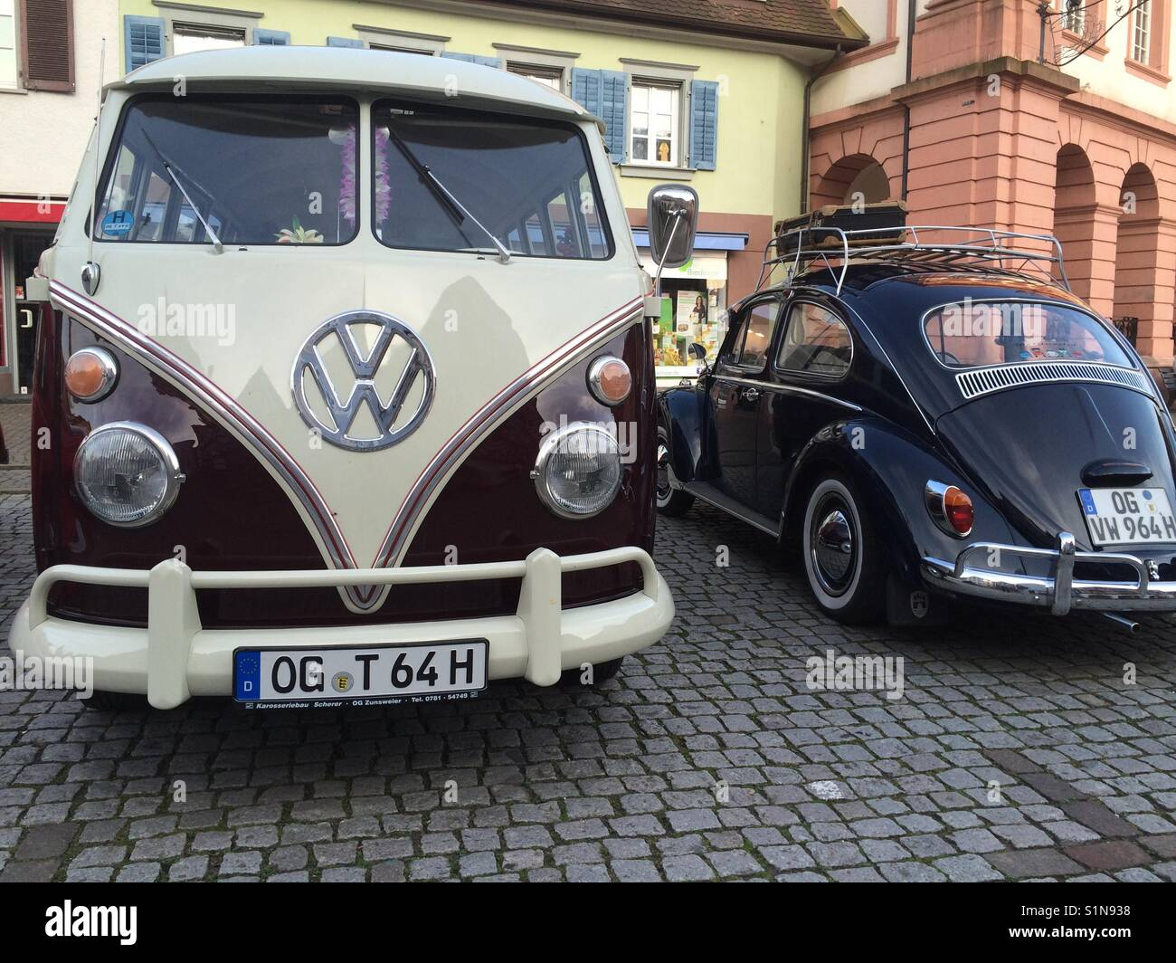 VW bus and VW Beatle Oldtimers in Schwarzwald Germany on cobblestones - Stock Image