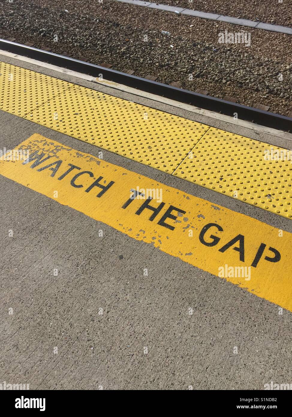 A Watch the Gap sign at a train station in New Haven, CT. - Stock Image