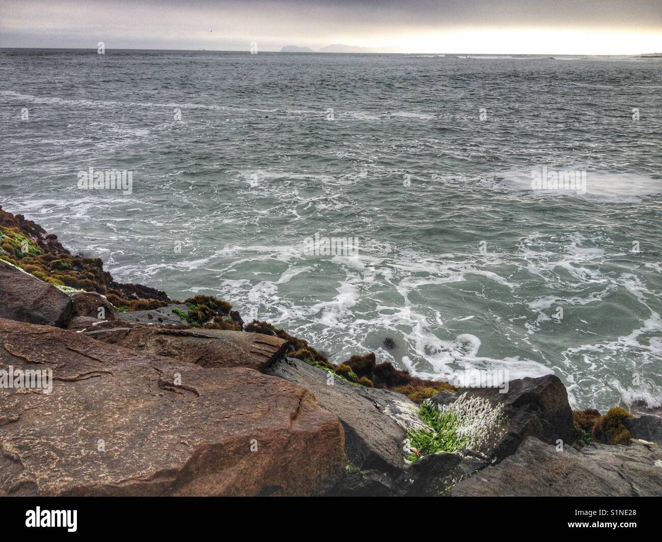 Choppy waters of the Pacific Ocean seen from Lima, Peru. - Stock Image