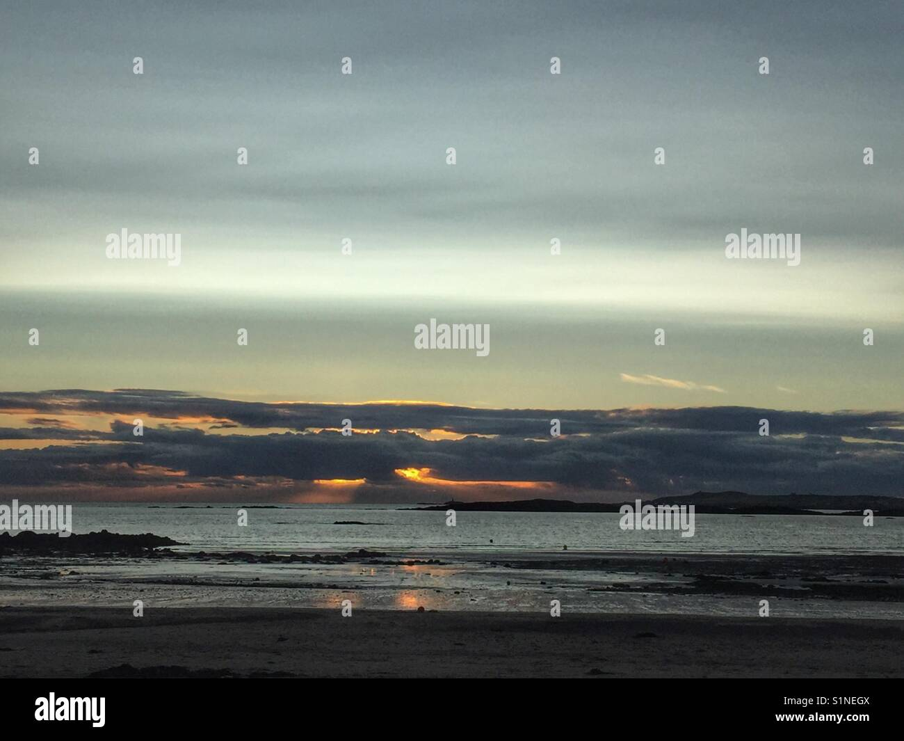 Rhosneigr sunset, mid September, Anglesey, North Wales - Stock Image