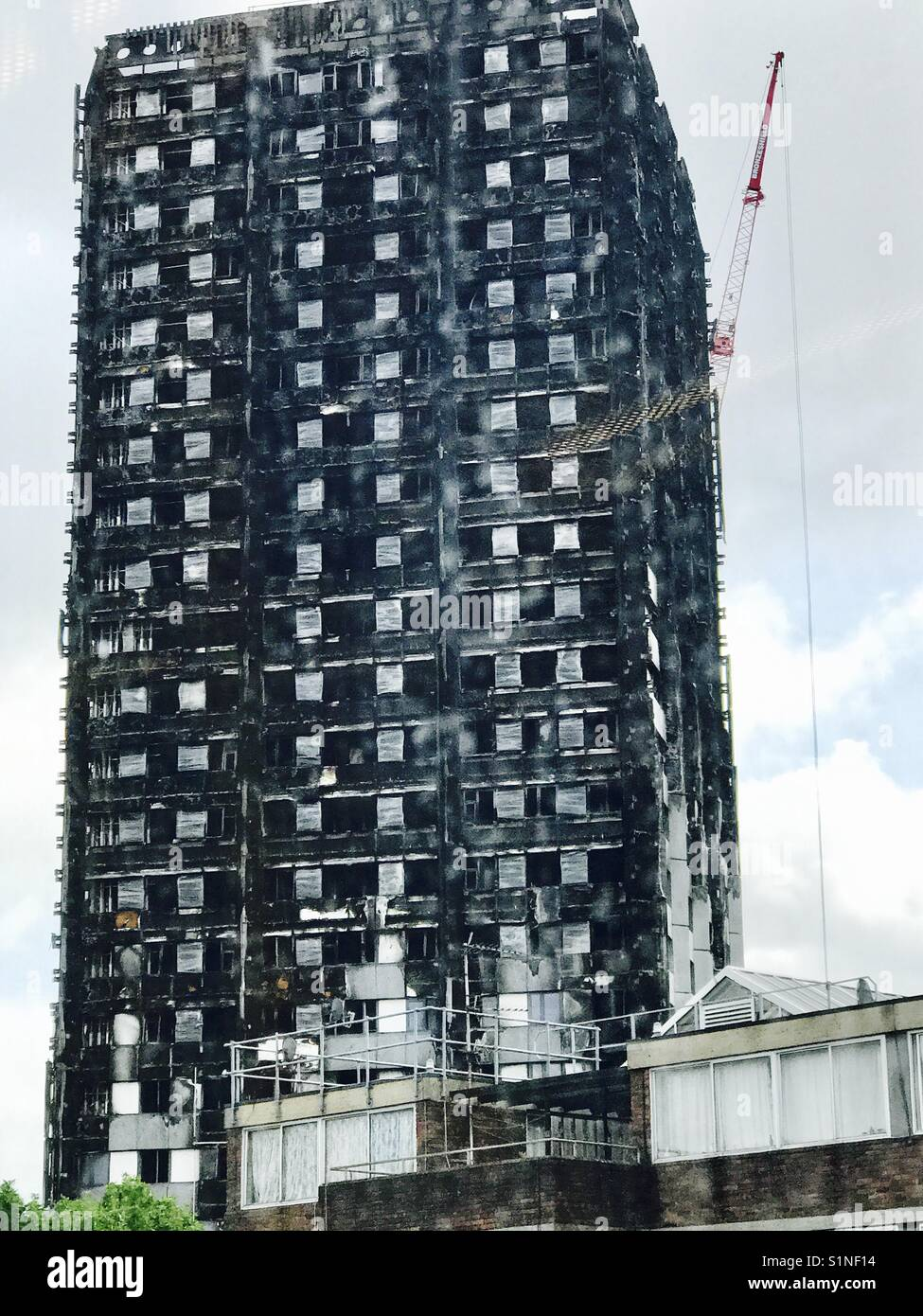 Grenfell Tower two months after the fire the charred edifice - Stock Image