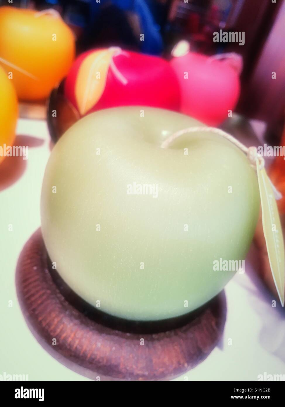 Wax candle in the shape of a green apple, USA - Stock Image