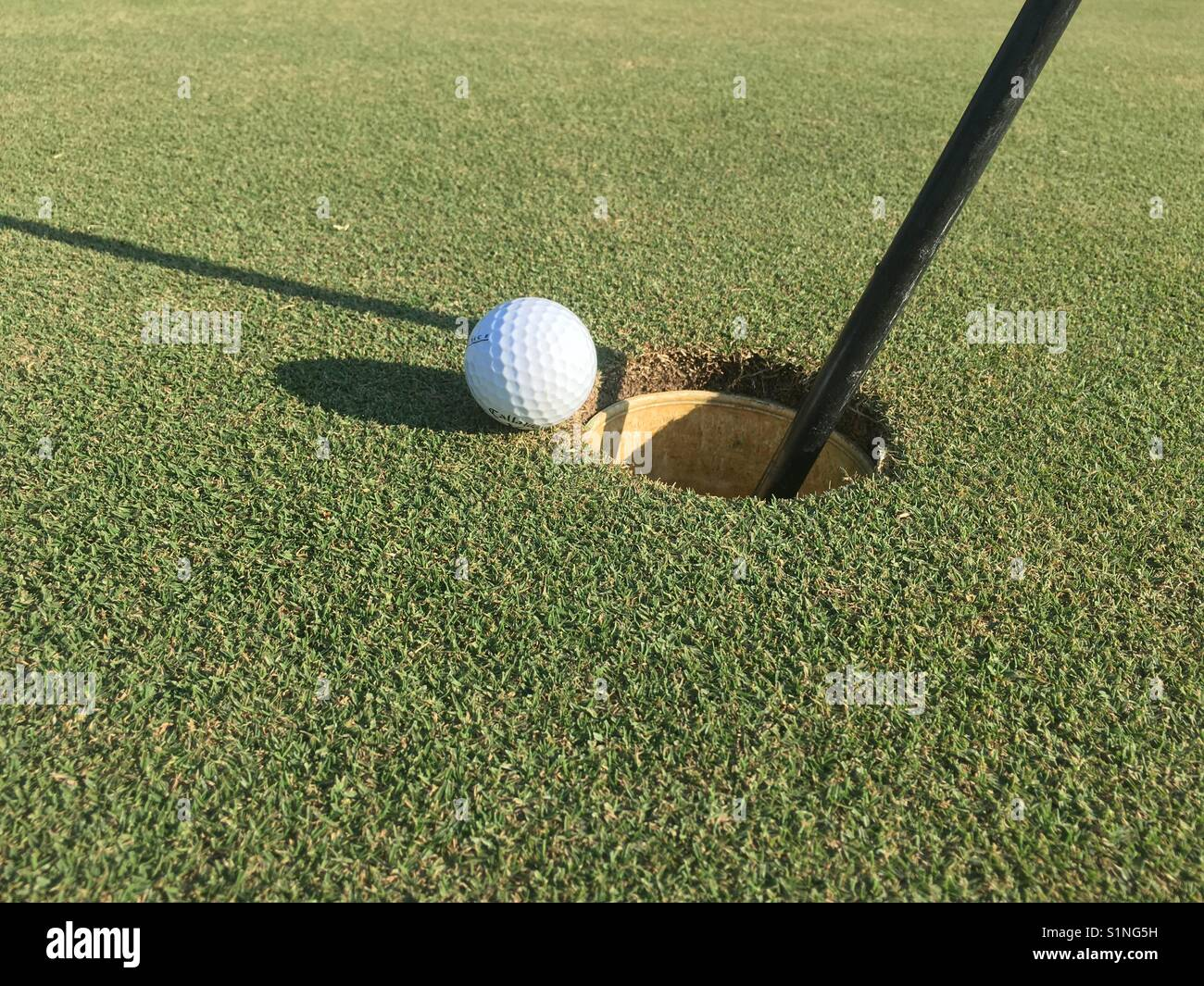 Golf Ball on the Edge - Stock Image