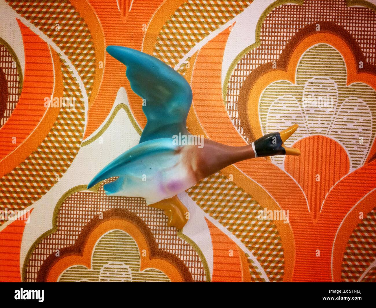 A Retro 1970s Wall Mounted Duck Flying Along On 70s