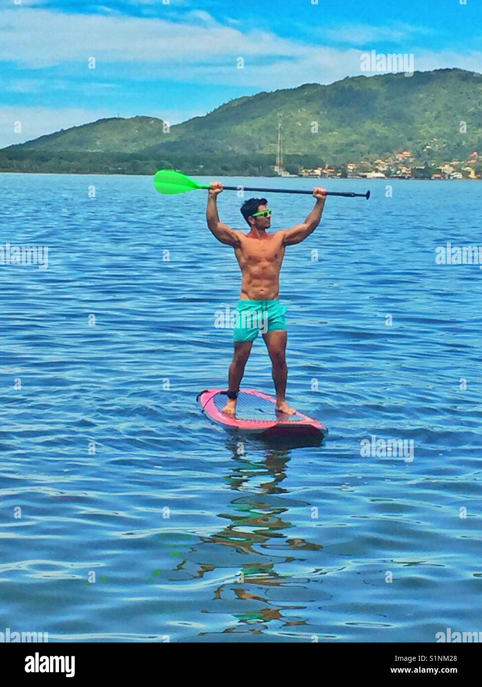 Standup paddles in the lake - Stock Image