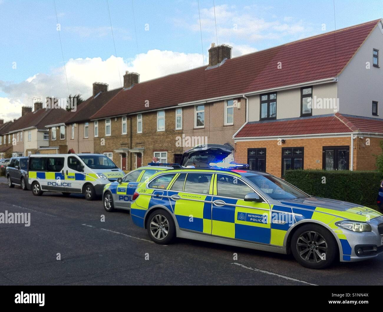 Metropolitan police cars attending a crime scene, on a residential road, dagenham, London, uk, 2017 - Stock Image