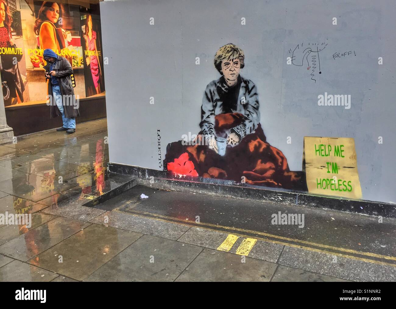 Street art by Loretto depicting UK Prime Minister Theresa May next to the sign 'help me I'm hopeless', - Stock Image