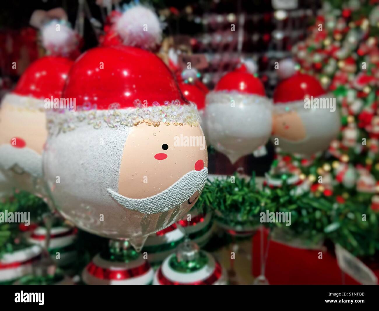 Whimsical Christmas Ornaments.Whimsical Santa Head Christmas Ornaments On Display At
