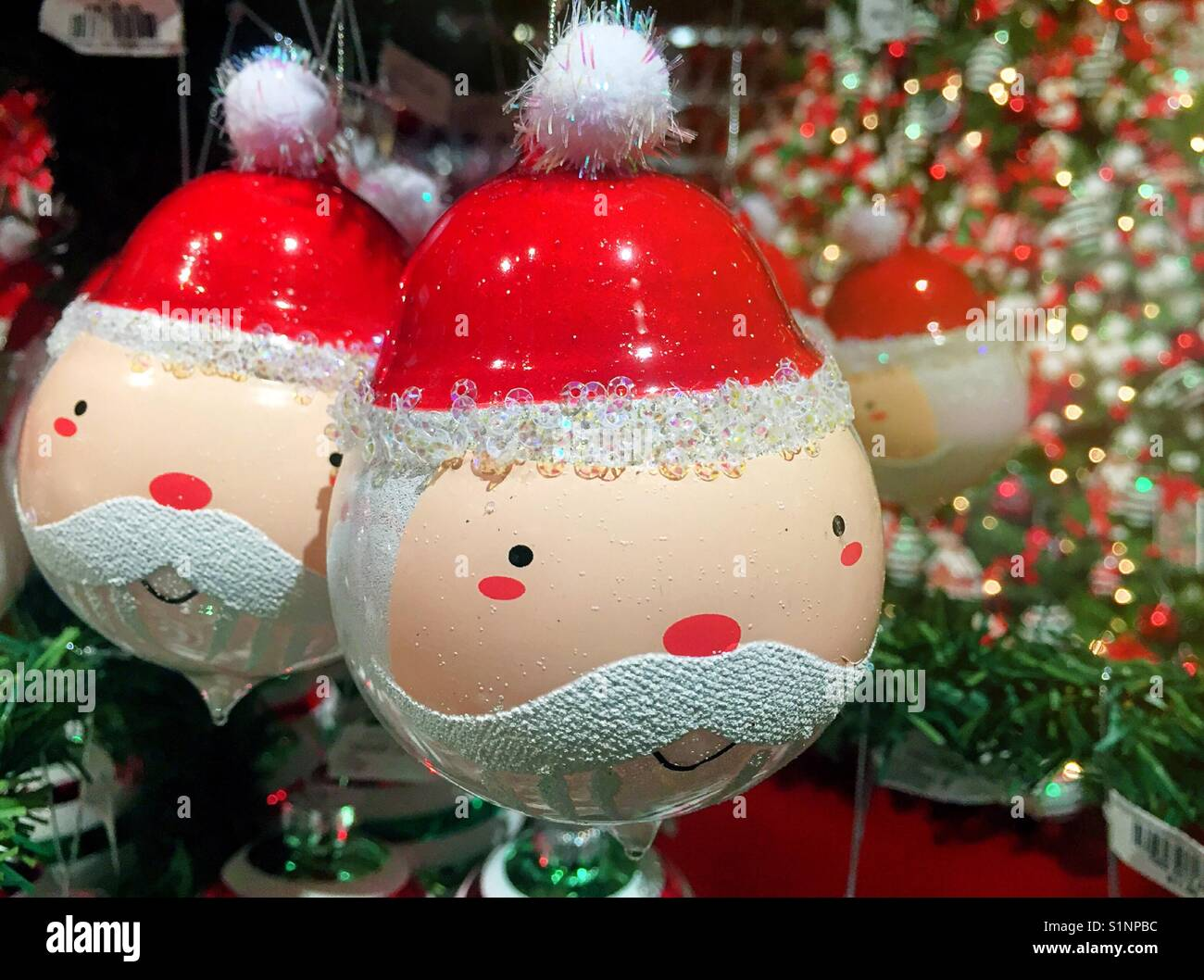 Whimsical Santa Claus ornaments on display in Macy\'s HOLIDAY Lane ...
