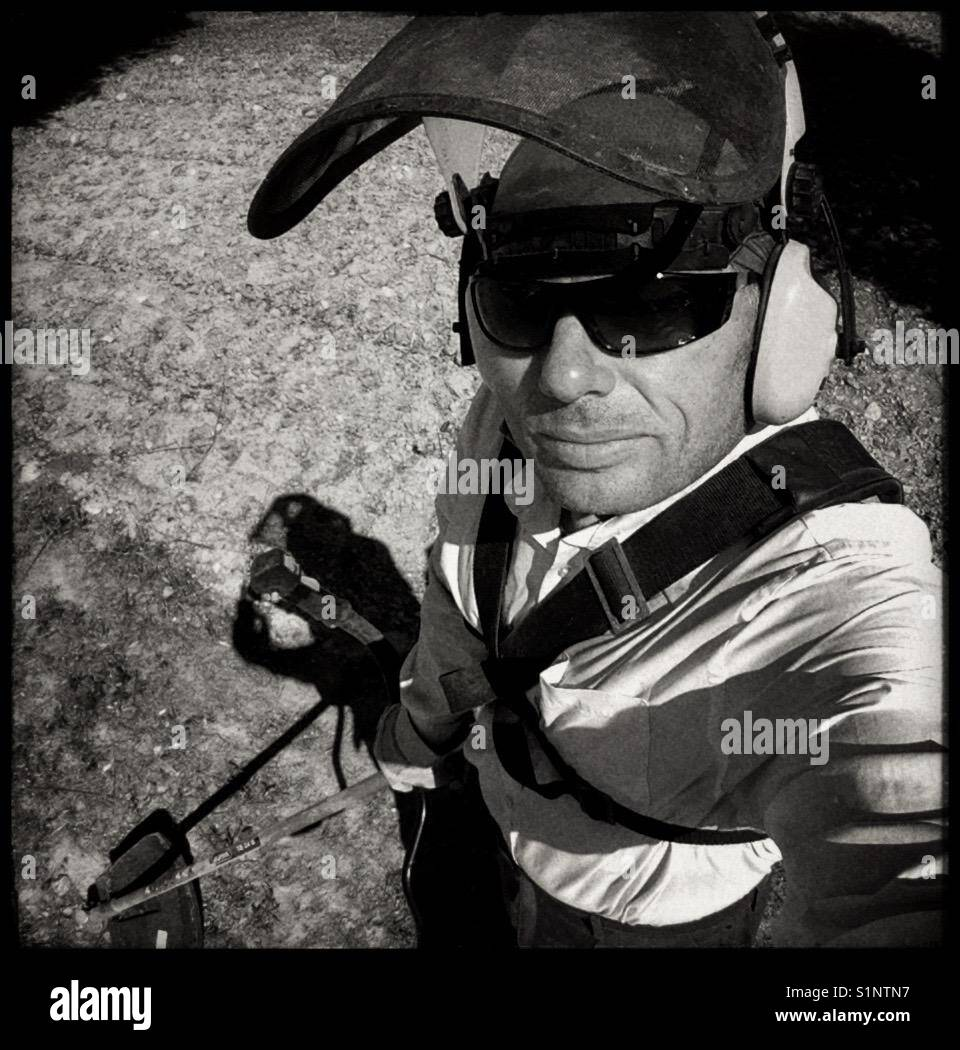 All geared up for strimming weeds. - Stock Image