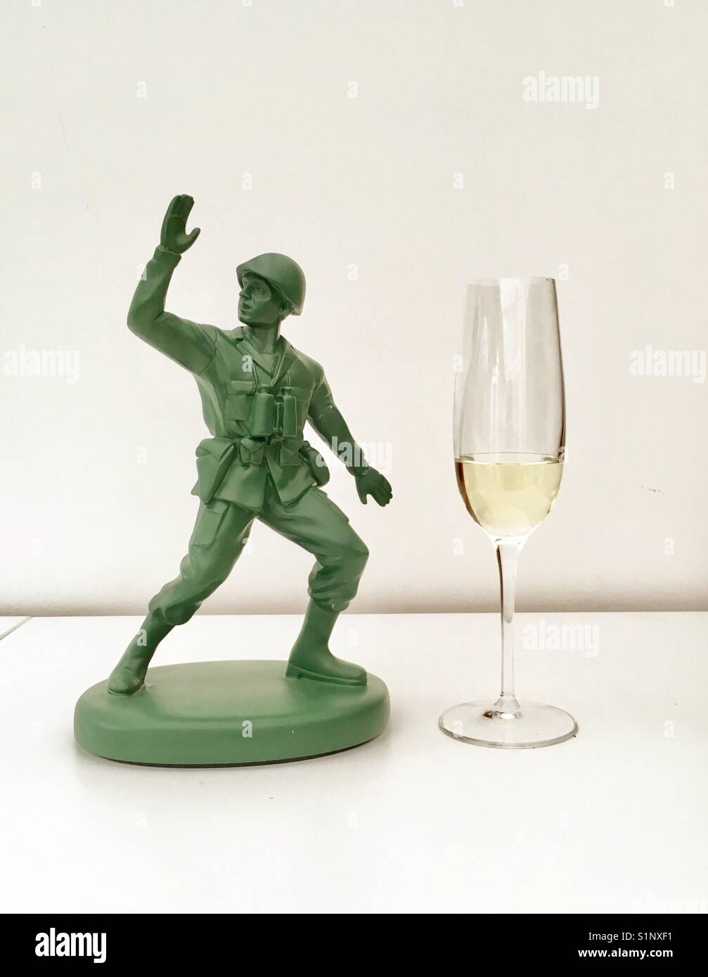 Toy soldier and champagne flute - Stock Image