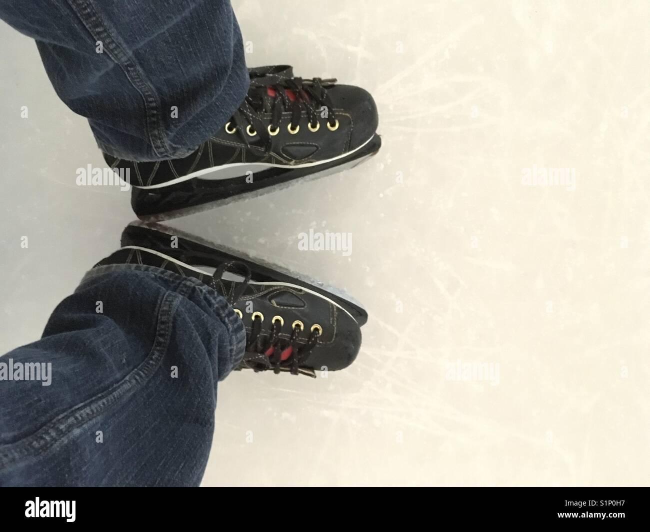 Preparing to ice skate - Stock Image
