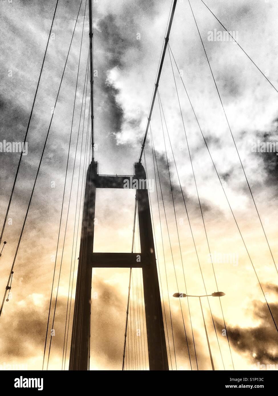 Split tone image of the Humber bridge single span bridge. England UK, low angle graphic viewpoint - Stock Image