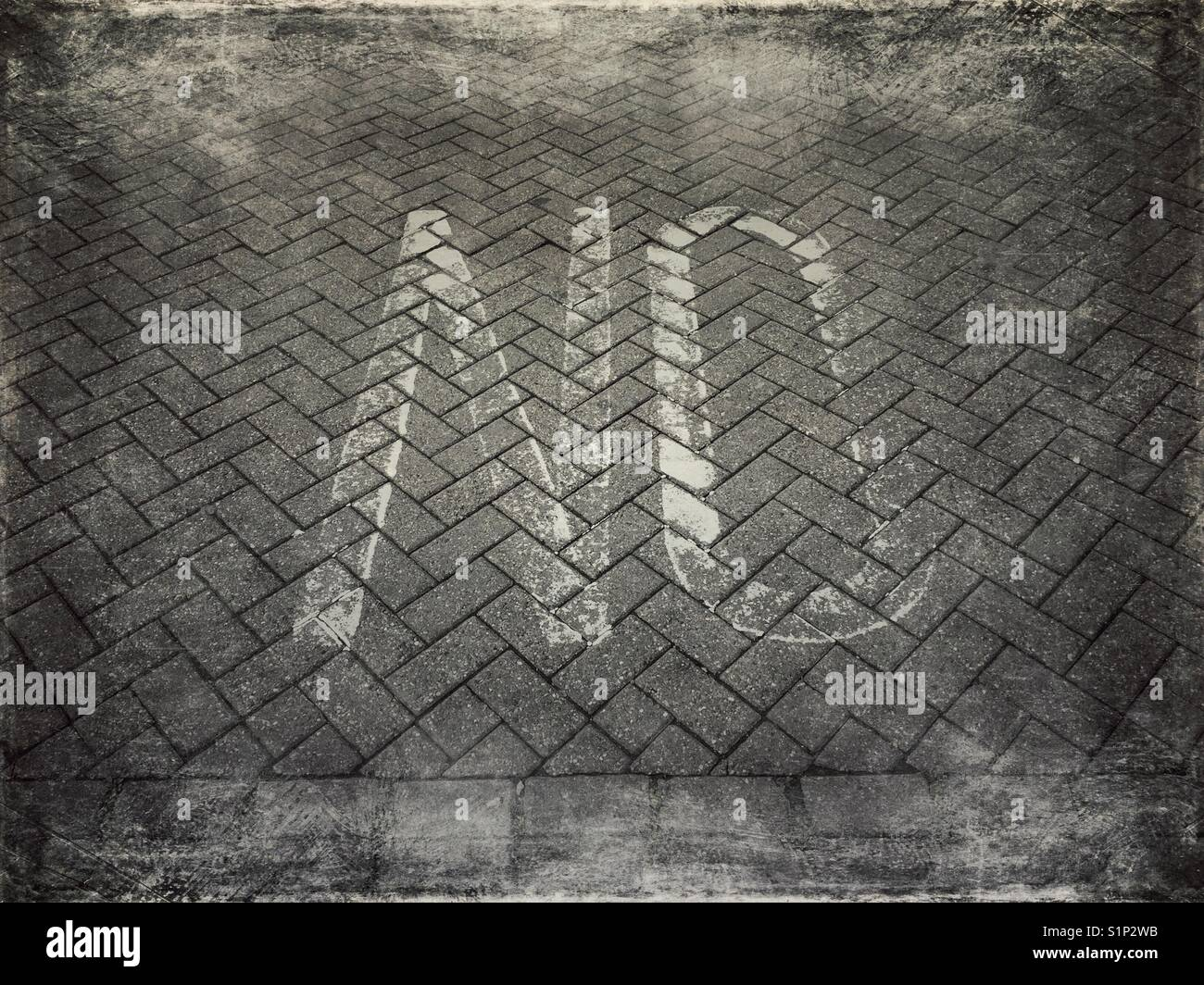 The word NO painted on the pavement - Stock Image