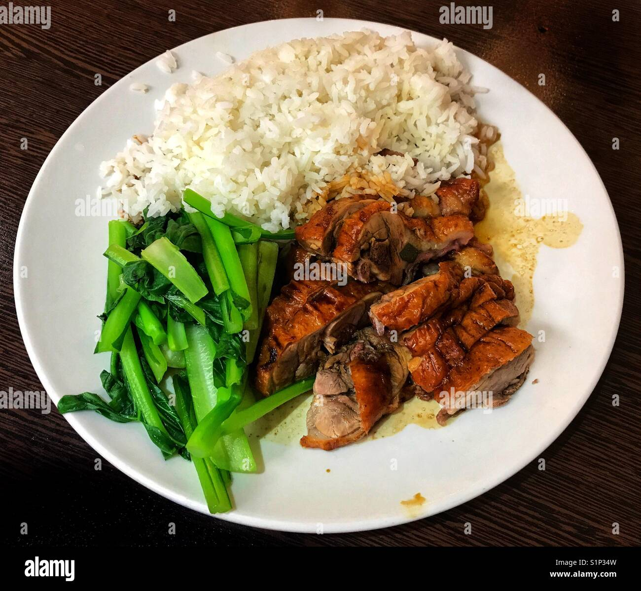 Cantonese roast duck with rice and vegetables - Stock Image