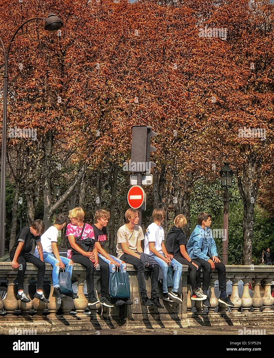 Group of teenage boys hanging out together. - Stock Image