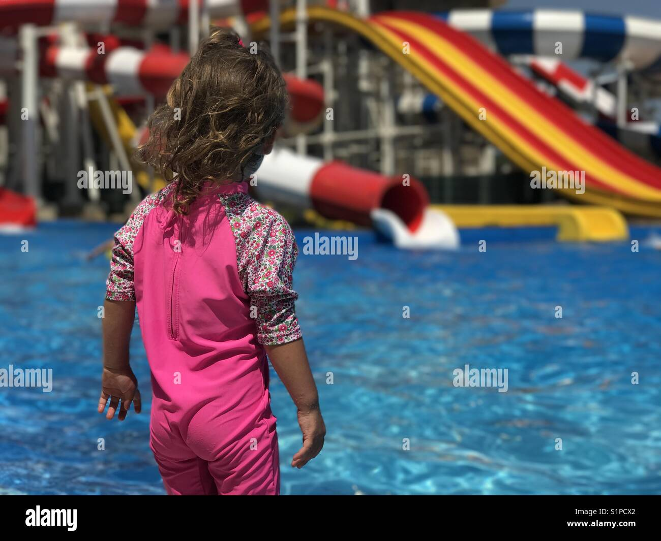 Girl having fun at aqua park - Stock Image