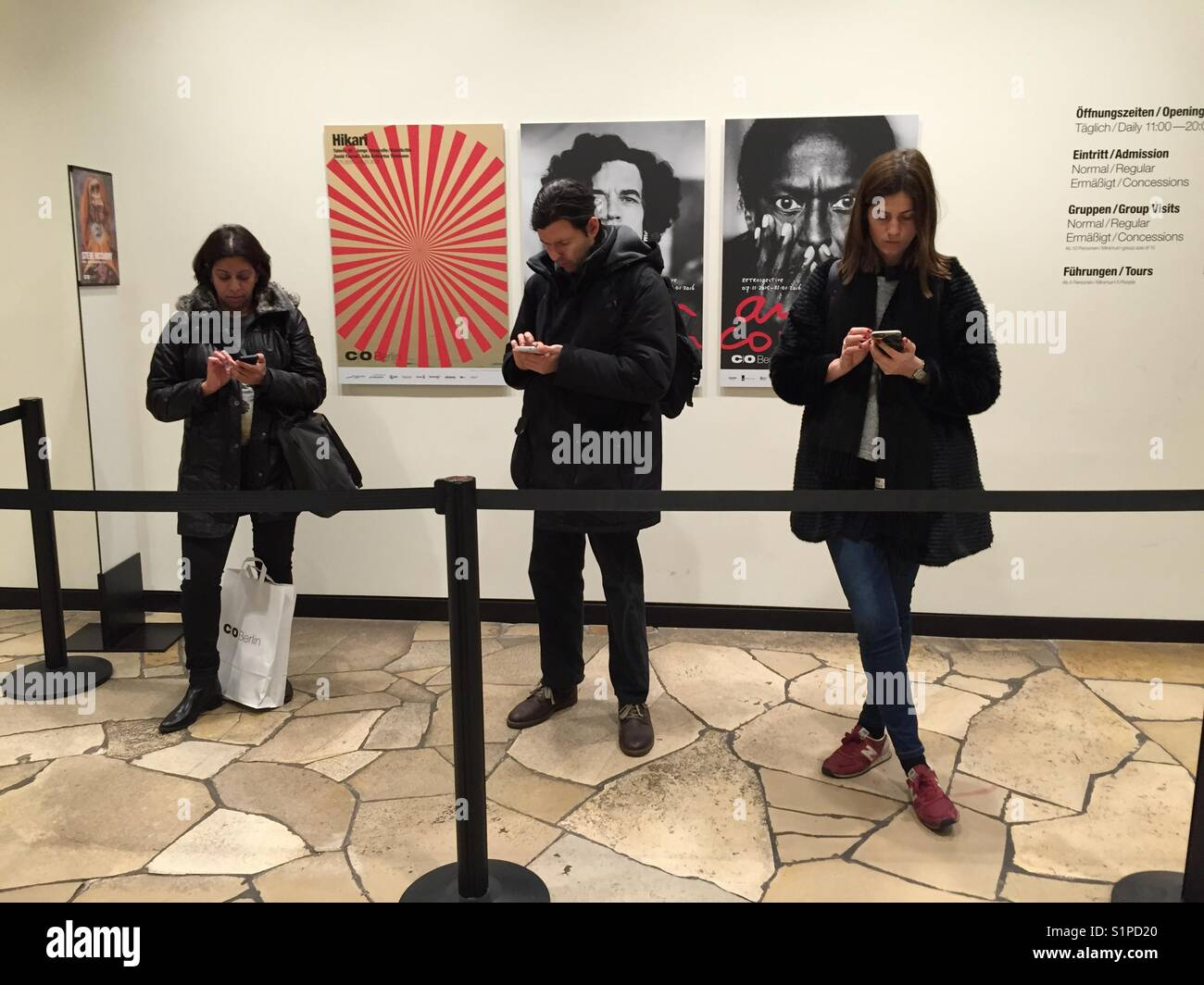 Berlin, America-House: People are using their mobile telephon. - Stock Image