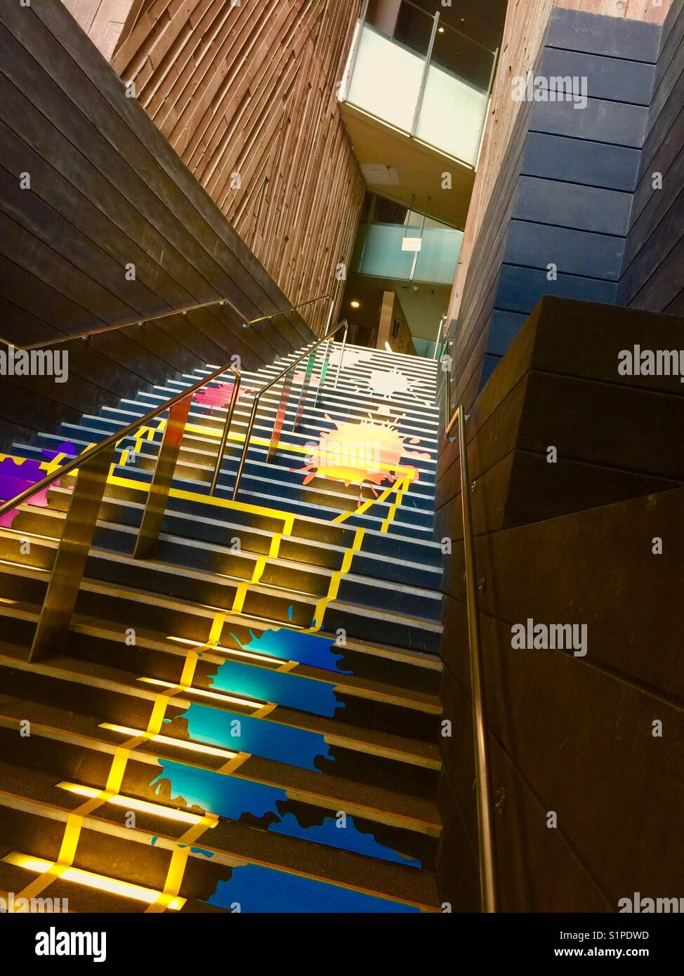 Colourful flight of stairs - Stock Image