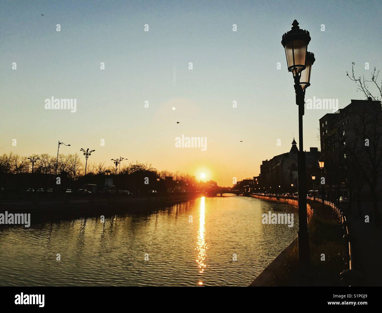Bucharest at sunset. - Stock Image