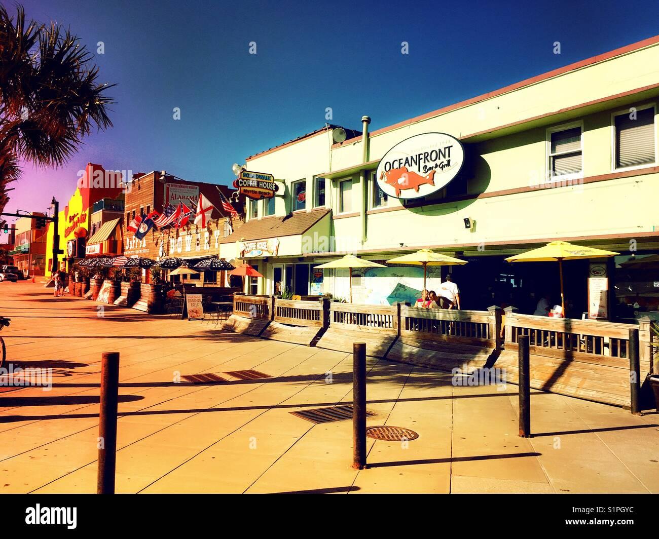Oceanfront boardwalk, shops and bars, Myrtle Beach, South Carolina, USA Stock Photo