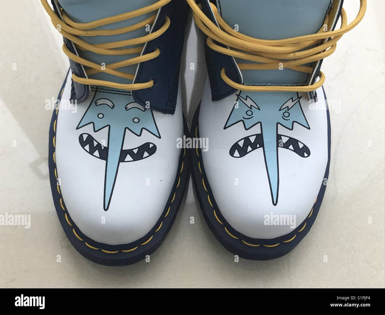 Adventure Time boots. - Stock Image
