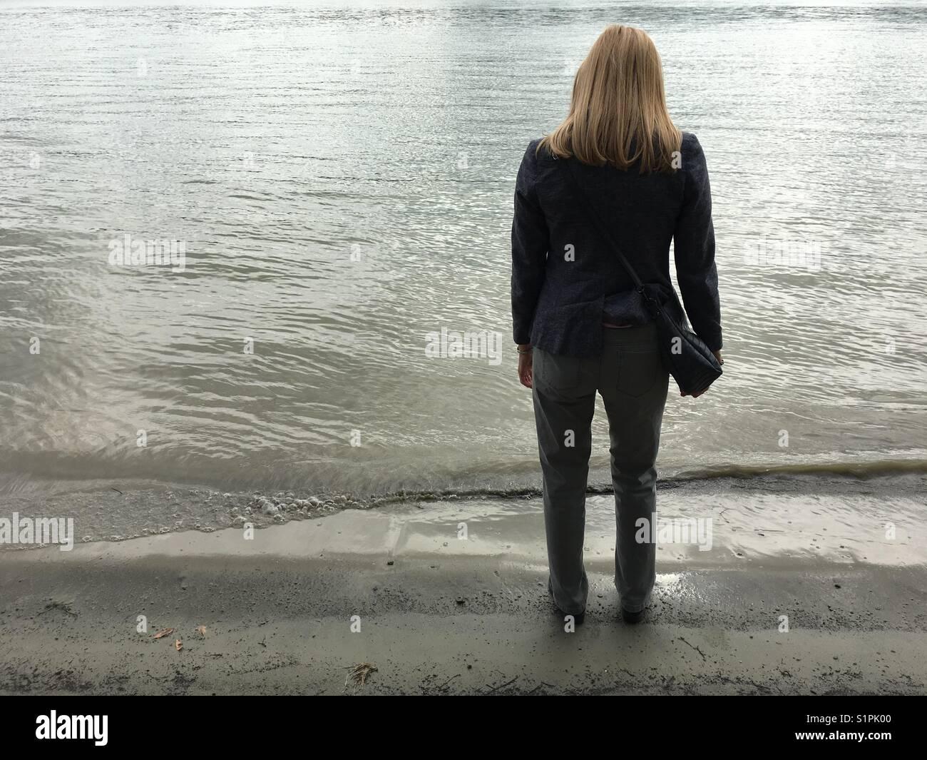 Standing on a bank of river Danube in Novi Sad in Serbia - Stock Image