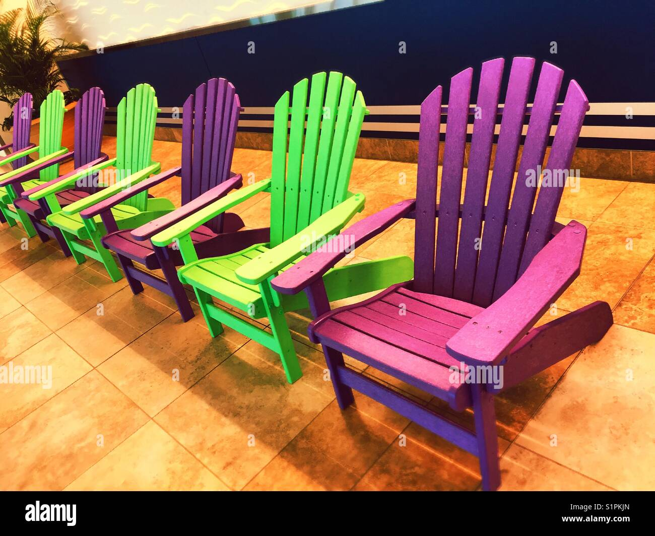 Colorful Adirondack chairs in passenger terminal, Myrtle ...