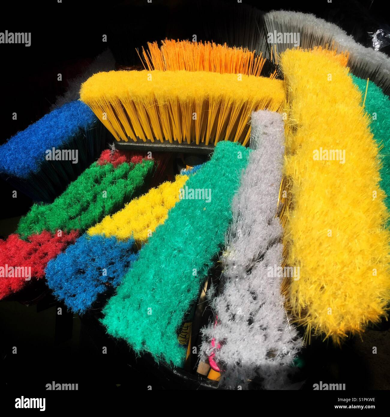 Colorful mop and broom heads - Stock Image