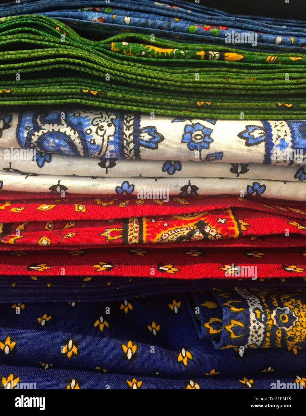 Colorful, cotton scarves  in a stack. Beautiful abstract designs. - Stock Image