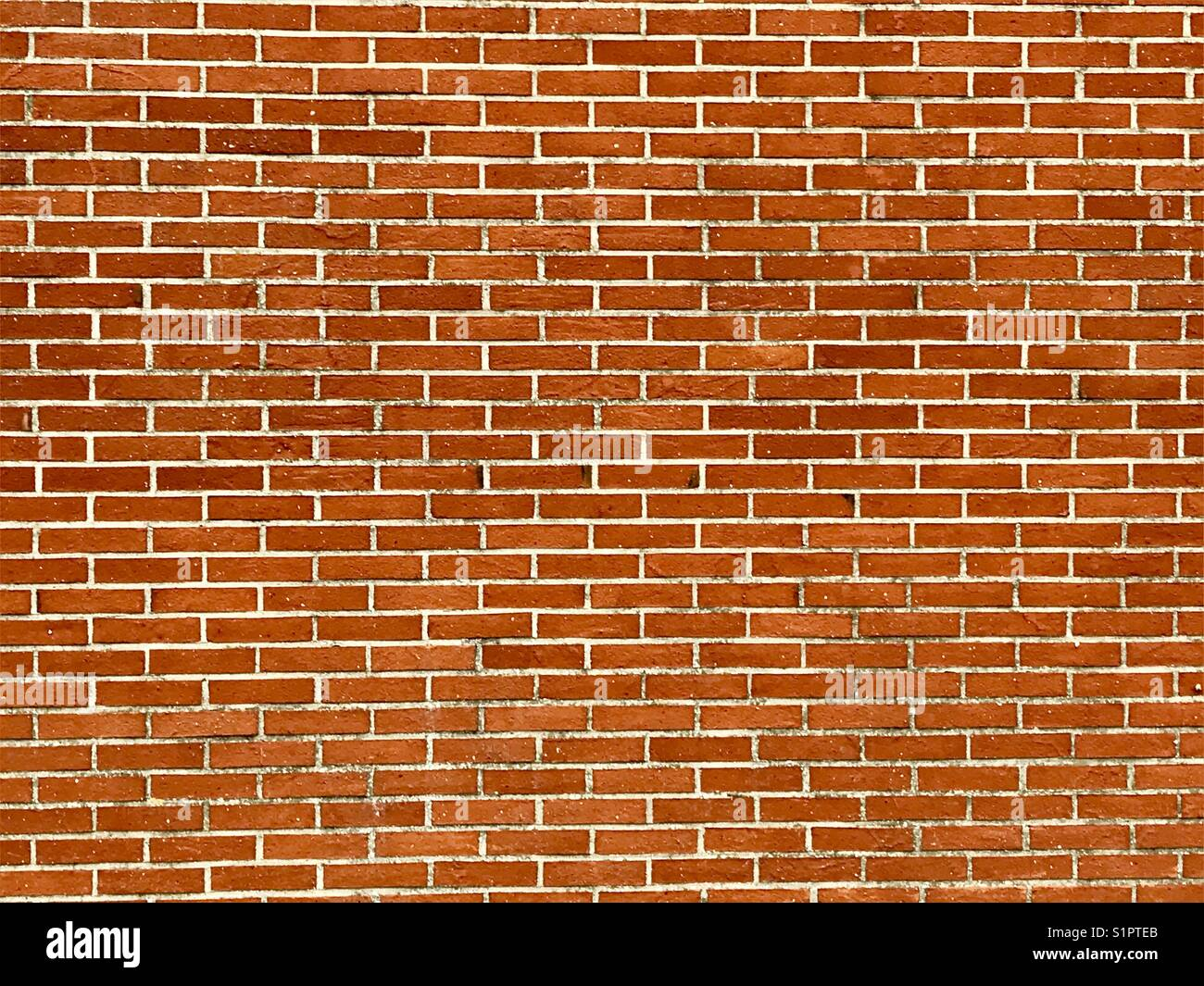 Wall of the red bricks as background - Stock Image