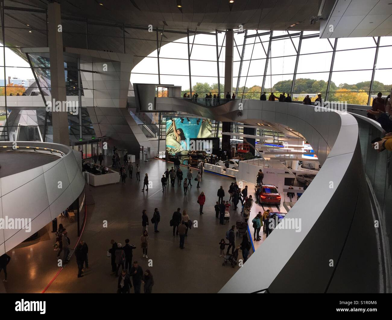 BMW Museum in Munich, Germany seen from the first floor inside of the entrance hall - Stock Image