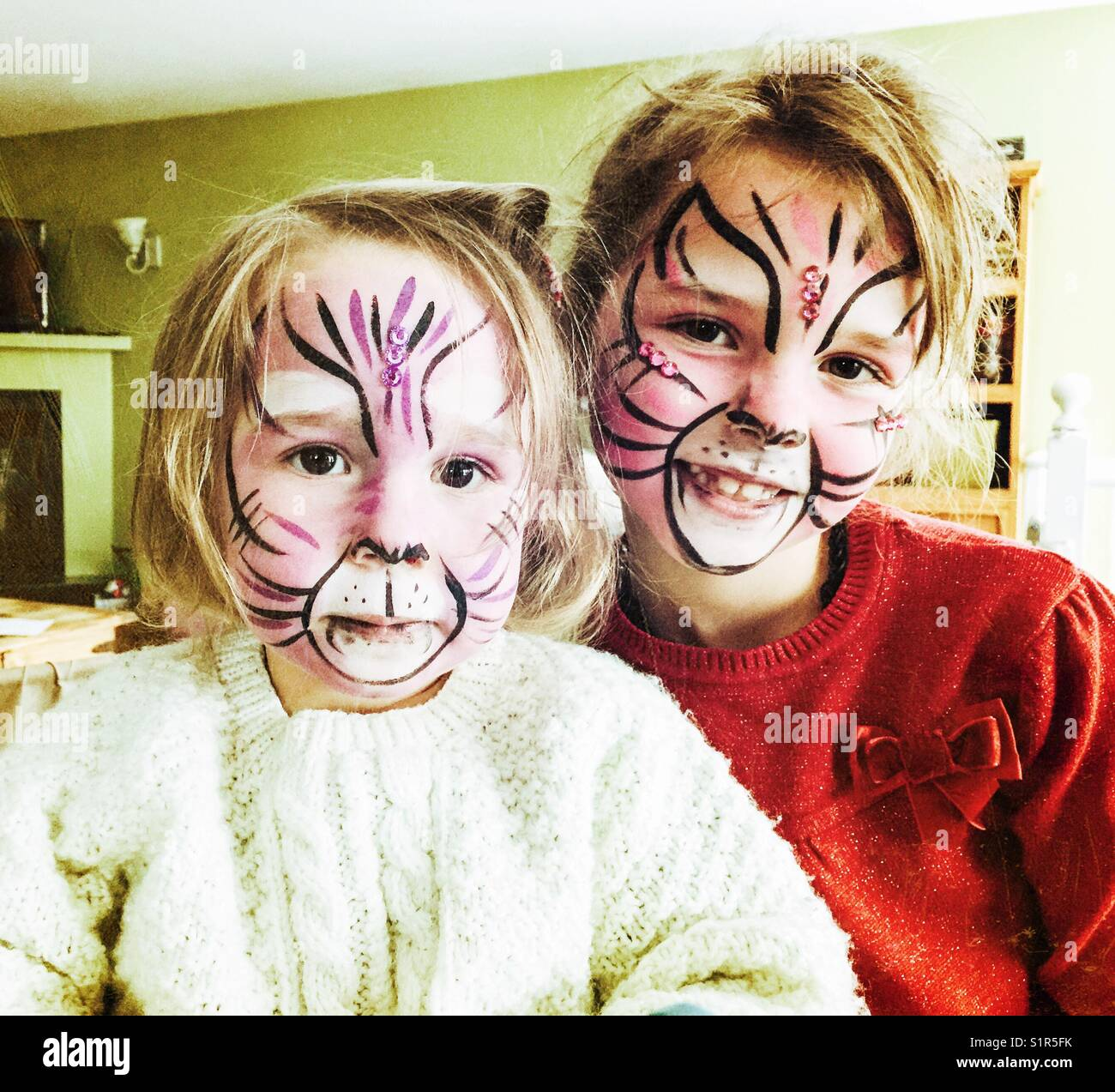 Two girls with face paint - Stock Image