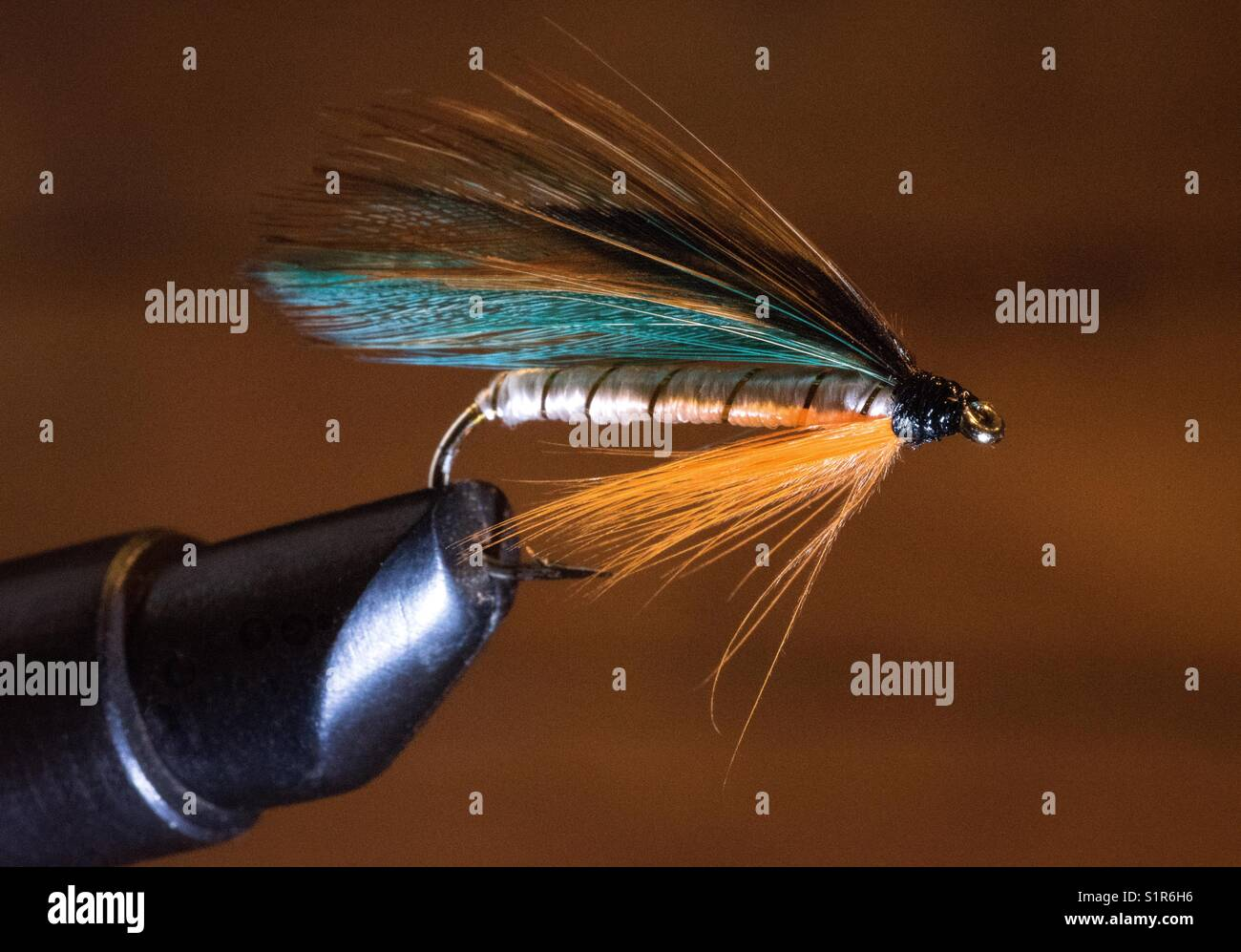 Tying a fly Stock Photo