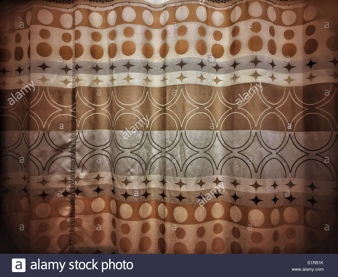 Kitschy curtains in a hospital waiting area - Stock Image