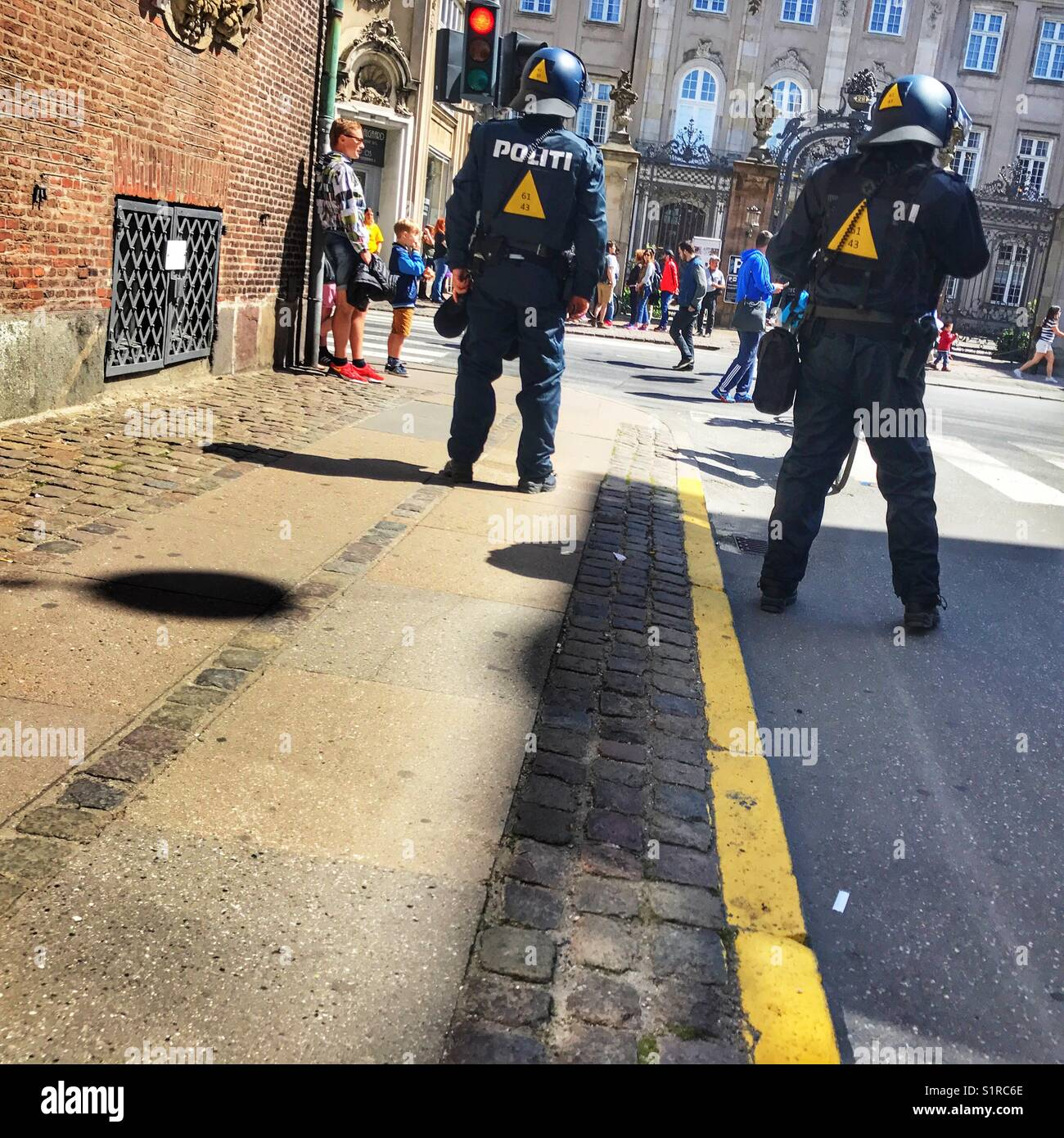 Two police officers keeping a close watch on football fans, Copenhagen, Denmark - Stock Image