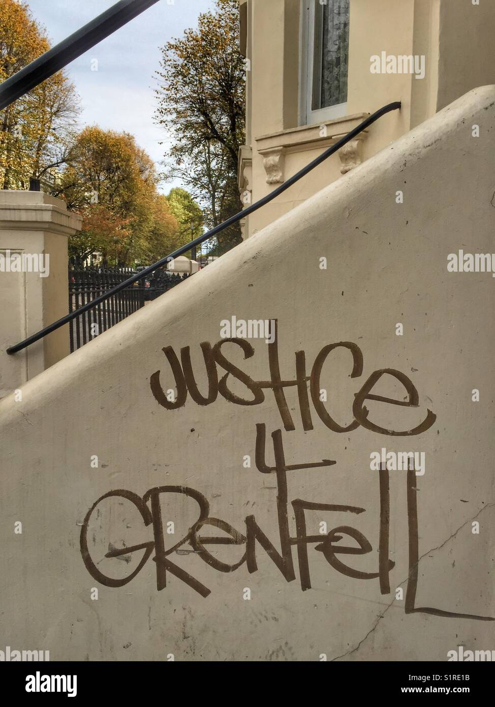 Justice 4 Grenfell graffiti outside a house on Cambridge Gardens in North London, England on October 28 2017 - Stock Image