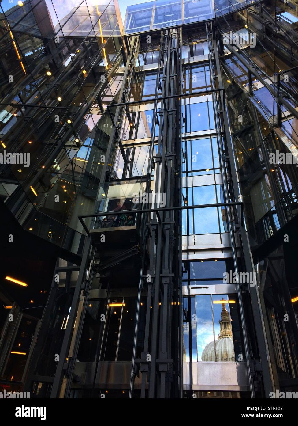 One New Change elevator with the reflection of St Paul's Cathedral. London - Stock Image