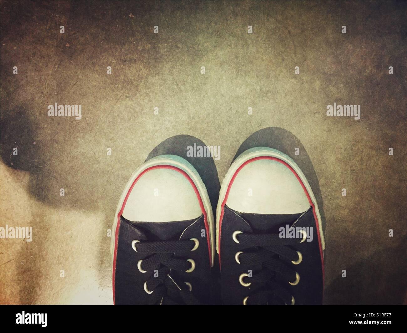 Selfie of black sneakers - Stock Image