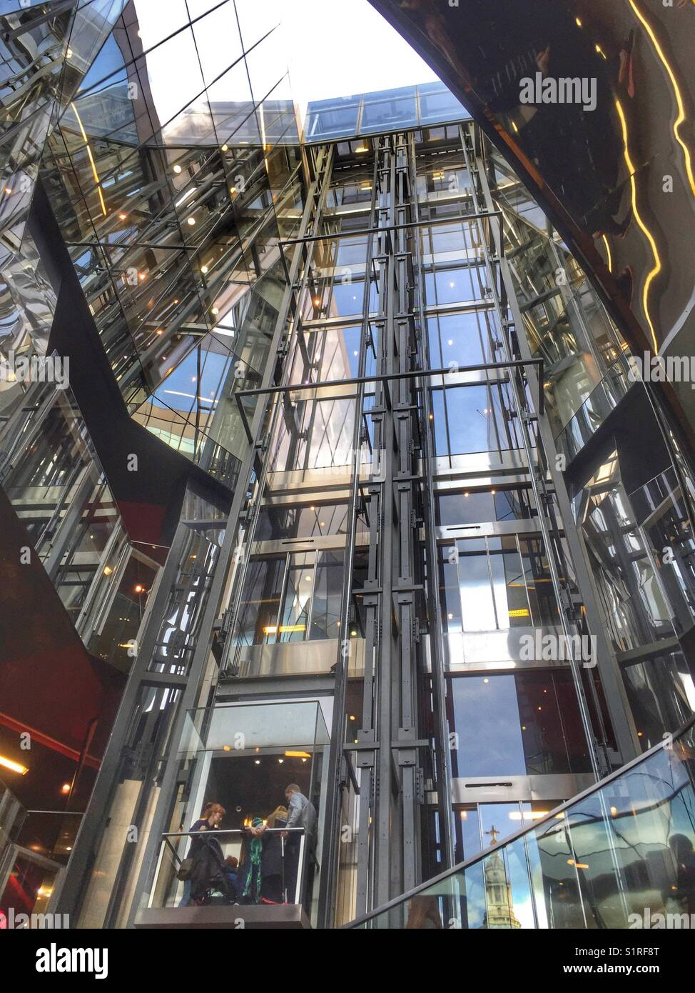 People travel in a lift at 1, New Change owned by Land Securities in London, England - Stock Image