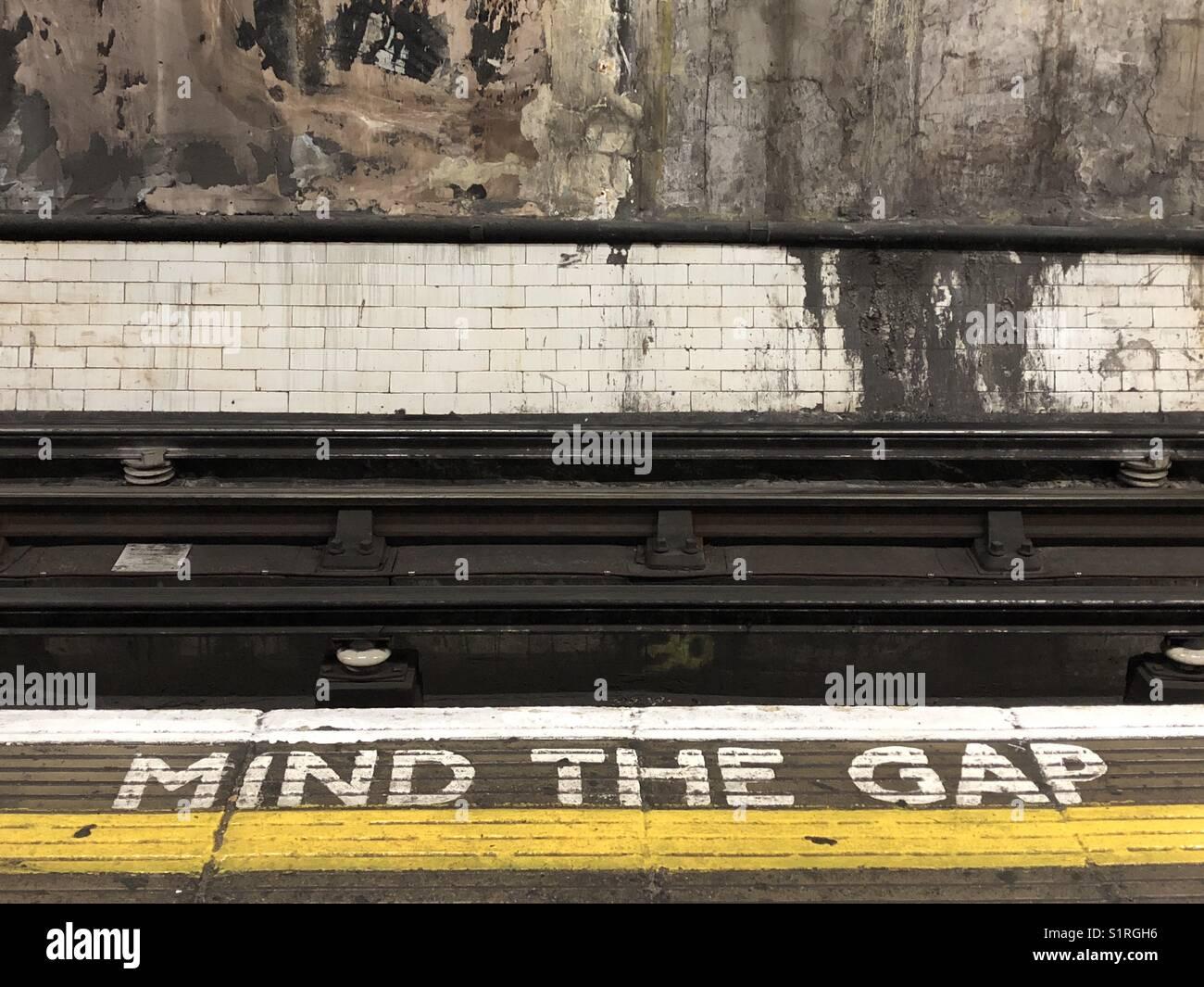 Mind the gap, London Underground platform and track - Stock Image