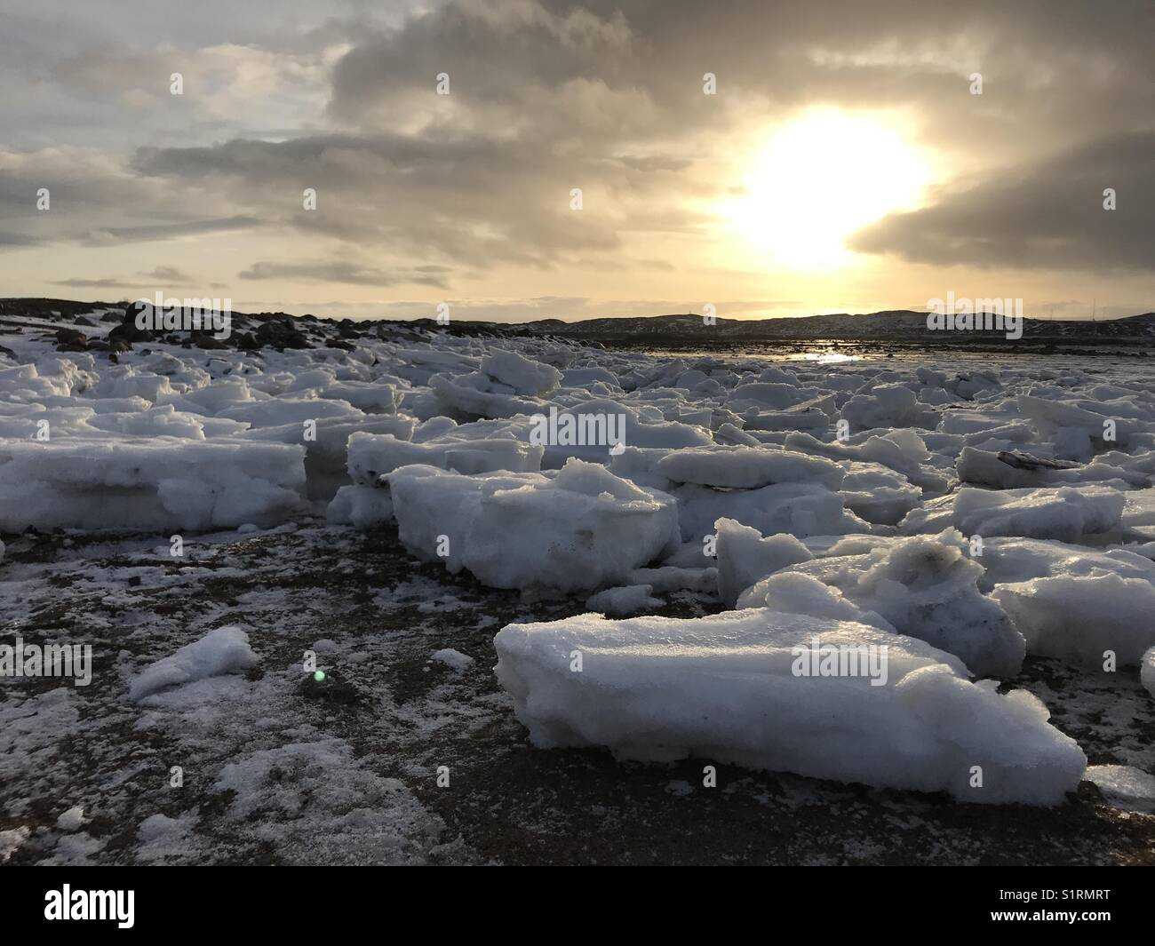 Ice on Frobisher Bay, Nunavut, Canada, during sunset - Stock Image