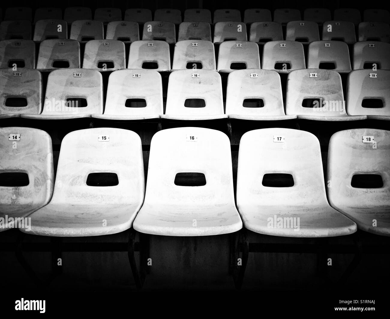 Empty seats at sports arena - Stock Image