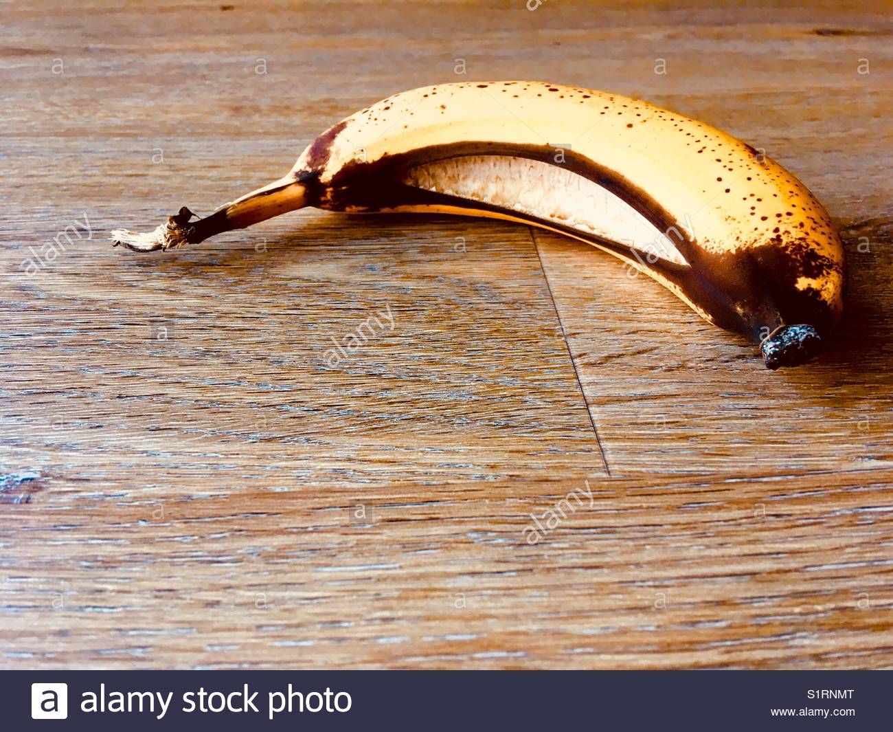 Banana with split skin - Stock Image