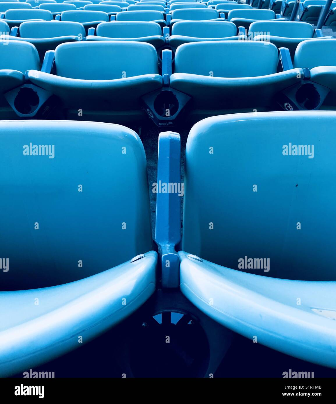 The rows of blue chairs in the reserve level at dodger stadium. Los Angeles, California USA. - Stock Image