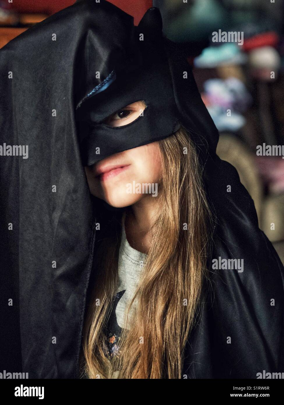 5 year old girl dressed up in Batman costume - Stock Image