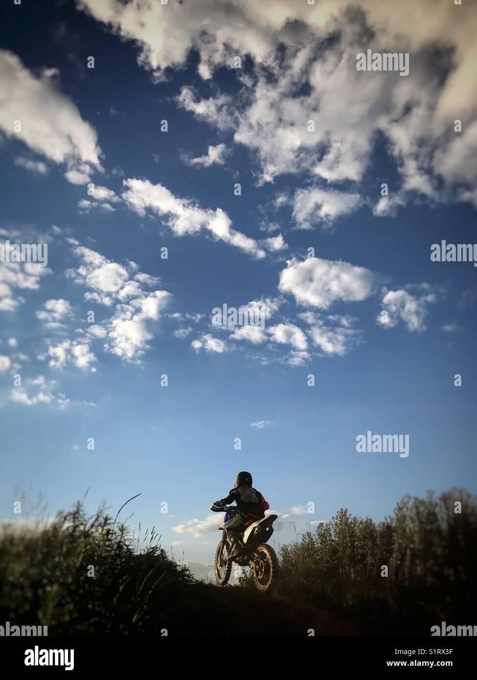 Boy riding a dirt bike - Stock Image